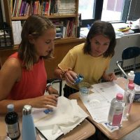 University of Connecticut Early College Experience (UConn ECE) Concurrent Enrollment – Two female high schools students conducting science experiment