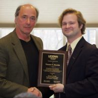 University of Connecticut Early College Experience (UConn ECE) Concurrent Enrollment - a male winner receiving his award