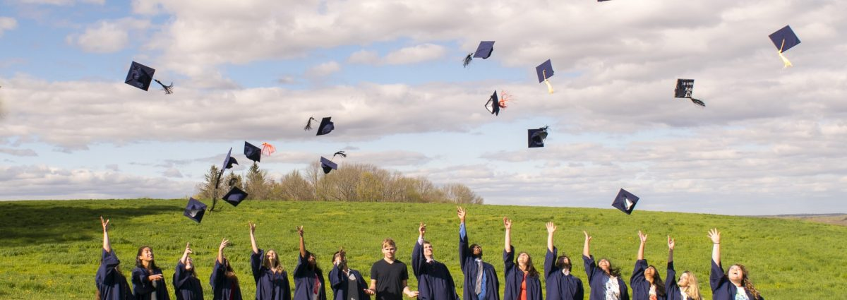 Group of students in throwing caps in to air